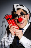 Funny clown with sticks of dynamite — Stock Photo
