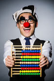 Funny clown with abacus — Stock Photo