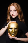 Redhead woman with mask — Stock Photo
