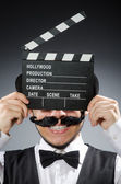 Man with movie clapper board — Stok fotoğraf