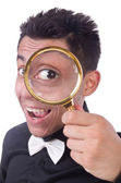 Funny man with magnifying glass — Stock fotografie