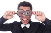 Funny man with magnifying glass — Stock Photo