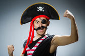Funny pirate in the dark studio — Stock Photo