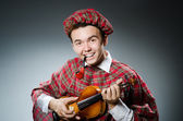 Funny scotsman with violin fiddle — Stock Photo