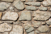 Wall made of various stones — Stock Photo