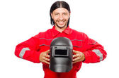 Welder in red overalls — Stockfoto