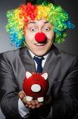 Clown with piggybank — Stock Photo