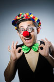 Funny clown adjusting bow — Stock Photo