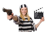 Funny prison inmate with clapboard and gun — Stock Photo