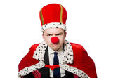 Man with crown and clown nose — Stock Photo