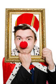 King businessman with clown nose — Stock Photo