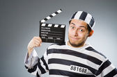 Prisoner  with  movie clapper — Stock Photo