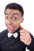 Funny man with magnifying glass — Stockfoto