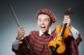 Scotsman with violin fiddle — Stock Photo
