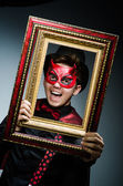 Funny devil with picture frame — Stock Photo