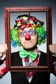 Clown with picture frame — Stock Photo