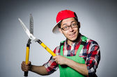 Man with giant shears — Stock Photo