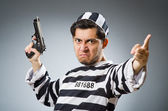 Prisoner with gun — Stock Photo