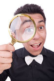 With magnifying glass — Stock Photo