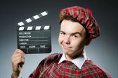 Scotsman with movie clapboard — Stock Photo