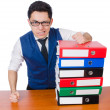 Funny man with lots of folders on white — Stock Photo #50876943