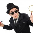 Young detective with pipe and magnifying glass — Stock Photo #50879879