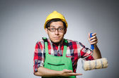 Funny painter with hardhat and roller — Stock Photo
