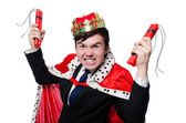 Businessman king with dynamite isolated on white — Stock Photo