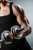 Muscular ripped bodybuilder with dumbbells — Stock Photo
