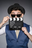 Funny man with movie clapper — Foto Stock