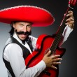 Mexican man with guitar isolated on white — Stock Photo #50882011
