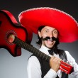 Mexican man with guitar isolated on white — Stock Photo #50882057