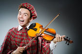 Funny scotsman with violin fiddle — Stock fotografie