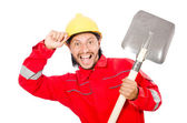 Man in red coveralls with spade — ストック写真
