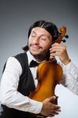 Funny fiddle violin player in musical concept — Stock Photo