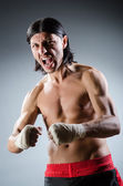 Ripped martial arts expert at training — Stockfoto