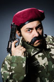 Funny soldier against the dark background — Stok fotoğraf