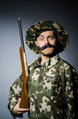 Funny soldier against the dark background — Stock Photo