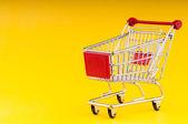 Shopping cart on seamless background — Stock Photo