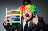 Funny clown businessman with abacus — Foto Stock