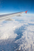 Airplane wing out of window — Stock Photo