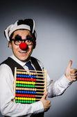 Clown mit rechenmaschine in der buchhaltung konzept — Stockfoto