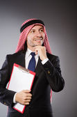 Arab man with paper binder — Stock Photo