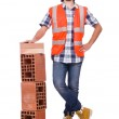 Builder with clay bricks isolated on white — Stock Photo