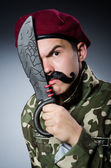 Funny soldier against the dark background — Foto de Stock