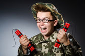 Funny soldier with red dynamite — Stock Photo