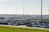 New cars parked at distribution center — Stock Photo