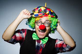 Funny clown against the dark background — Stock Photo