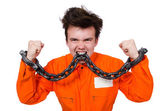 Young inmate with chains isolated on the white — Stock Photo