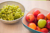Fruits in the bown on table — Stock Photo